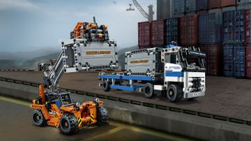 LEGO Technic - 42062 Container Yard - Transport huge amounts of cargo at the 2-in-1 LEGO® Technic Container Yard, featuring an articulated truck with detachable trailer and two large containers, plus a rugged container loader.