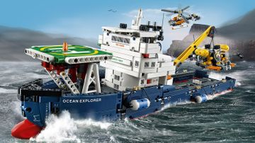 LEGO Technic - 42064 Ocean Explorer - The huge ship is in dark-blue, red and white colors, has a detailed hull with bulbous bow and two fenders, large captain's bridge, crane and a landing pad, plus a submarine and a helicopter!