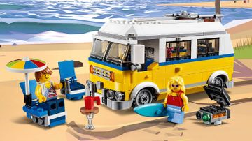 LEGO Creator 3-in-1 Sunshine Surfer Van - 31079 - A van packed with surfboards and beach stuff is parked near the ocean.