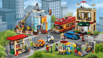 LEGO City Town - 60200 Capital City - The city has a kiosk, a gas station, a construction site, a hotel, their own police officer, a double decker tourist bus and a park with skate ramp, street musician and an ice cream truck.